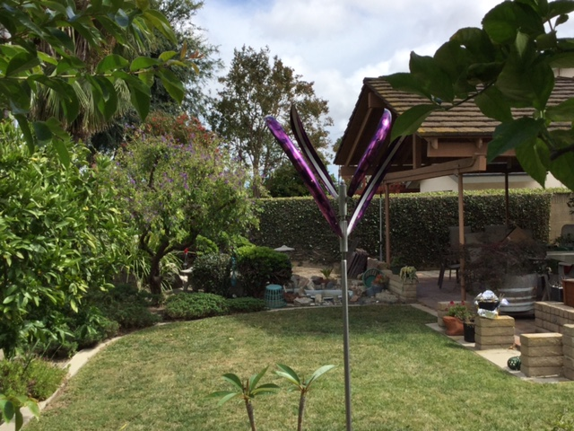 """Please let Mark know how pleased we are with our Blooming Lily 2 sculpture! Everyone who sees it really thinks it is lovely and graceful!"" - Linda Wong, Long Beach, CA"
