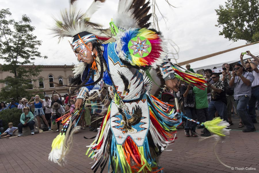 Native American dancer on the plaza; photo courtesy of Thosh Collins, SWAIA.org