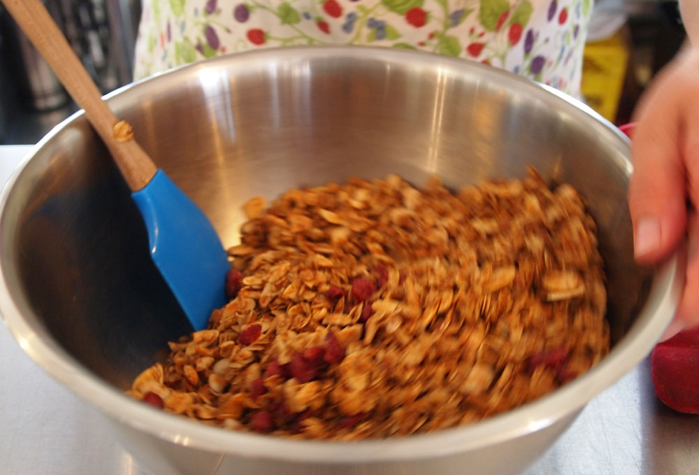 Mixing the new Copper Harbor Granola.  All natural, featuring cashews, almonds, and cranberries.