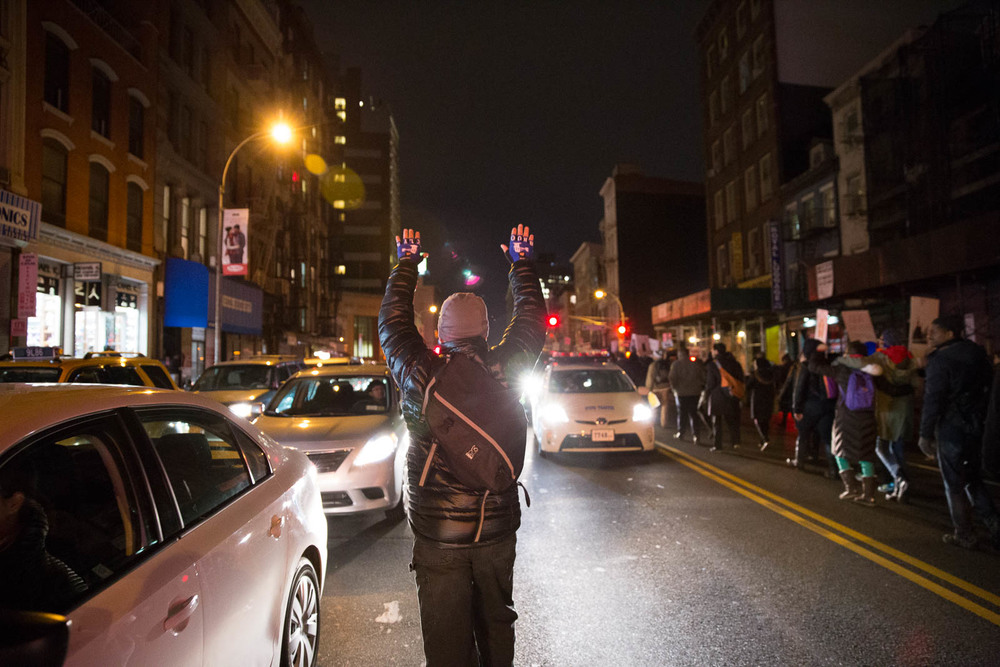 A man holds his hands up in protest of the failure to indict officer Daniel Pantaleo, the man who put Eric Garner in a chokehold in August. Garner died shortly thereafter. December 4th, 2014.