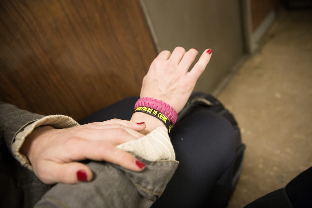 Ashley shows her bracelets, which remind her of her brother. They have remained very close throughout her transition.