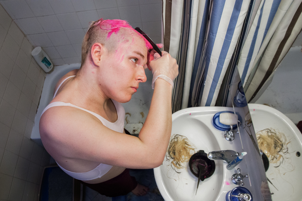 Kylie dyes and cuts her hair in her bathroom in a sports bra, dying it pink and shaving it to a mohawk on a whim.