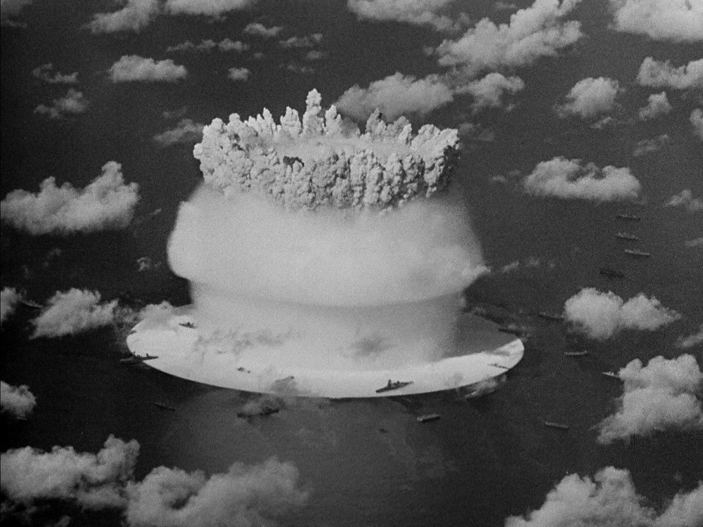 Viewed from every angle … ships surround the explosion at Bikini atoll. Still from Bruce Conner's CROSSROADS (1976, 35mm, b&w/sound, 37min.); © Conner Family Trust, San Francisco