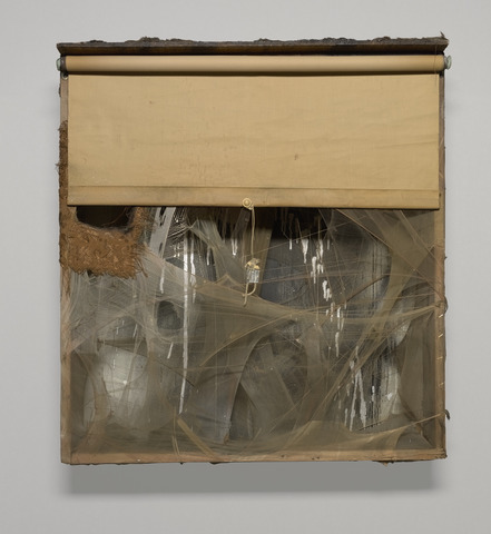 Bruce Conner, SPIDER LADY NEST, 1959 Wood box with aluminum paint, spray paint, window shade, nylon, thread, fabric, fur, lead customs seal on string, pearl bead, cotton ball, feathers, tassels, and cardboard Courtesy of Yale University Art Gallery; © Conner Family Trust, SF/Artists Rights Society (ARS), New York