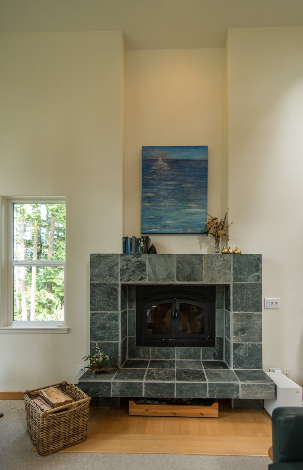 Alice (home owner) designed this fireplace......Love it. Simple elegance!!  Good job Alice !