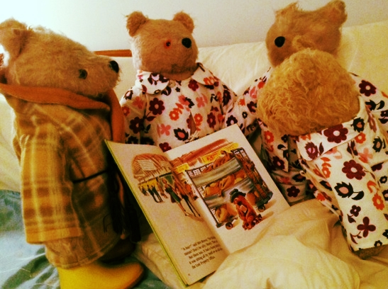 Gabrielle Design Paddington Bears showing off their nightime attire, pyjamas and dressing gown. I think the young man in his boots may have been breaking nightime protocol but maybe his feet were cold!!  It looks like they are reading A Bear Called Paddington before lights out