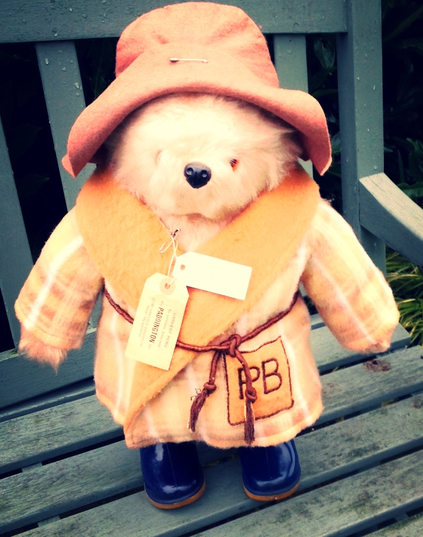 This original Gabrielle Bear in his dressing gown has Michael Bonds signature around is neck, looks like it was raining where he was too.