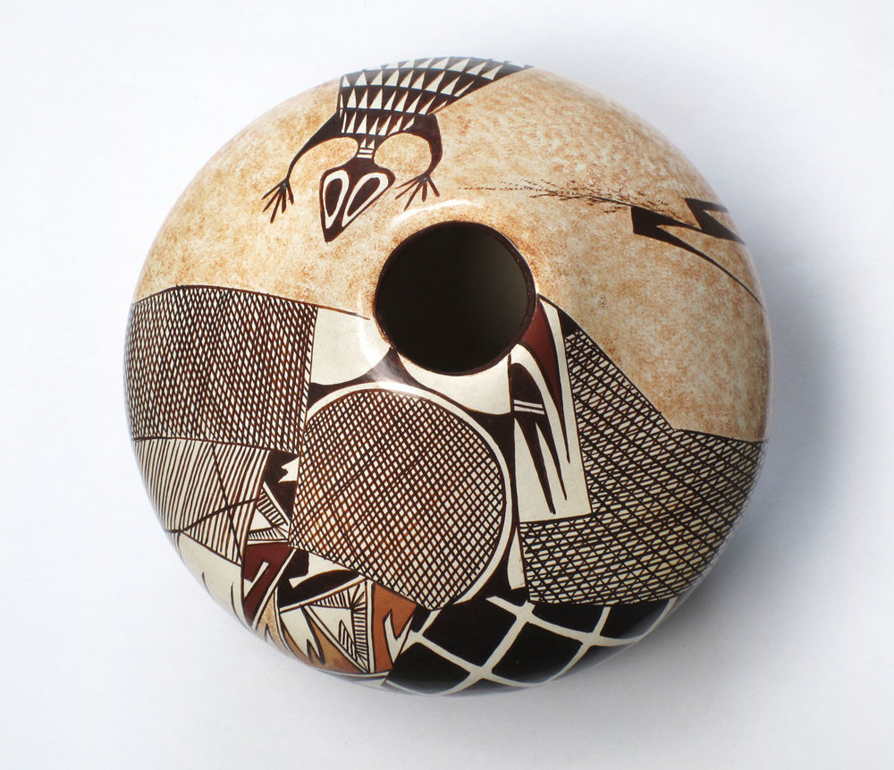 http://www.marcyburns.com/pottery-collection/hopi-polychrome-seed-jar-by-sylvia-naha