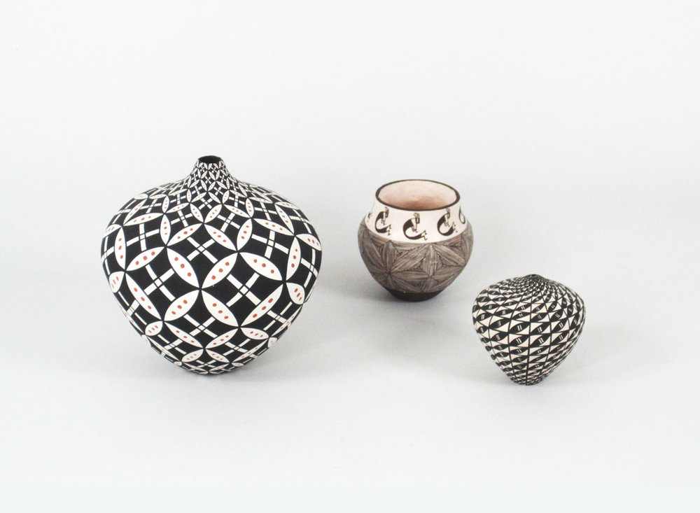 miniatures by: (left to right): Dorothy Torivio, Deborah Aragon, and Sandra Victorinoeach is described individually:  http://www.marcyburns.com/pottery-collection/acoma-small-jar-with-geometric-op-art-design ;   http://www.marcyburns.com/pottery-collection/acoma-miniature-seed-jar-by-1 ;   http://www.marcyburns.com/pottery-collection/acoma-miniature-seed-jar-by