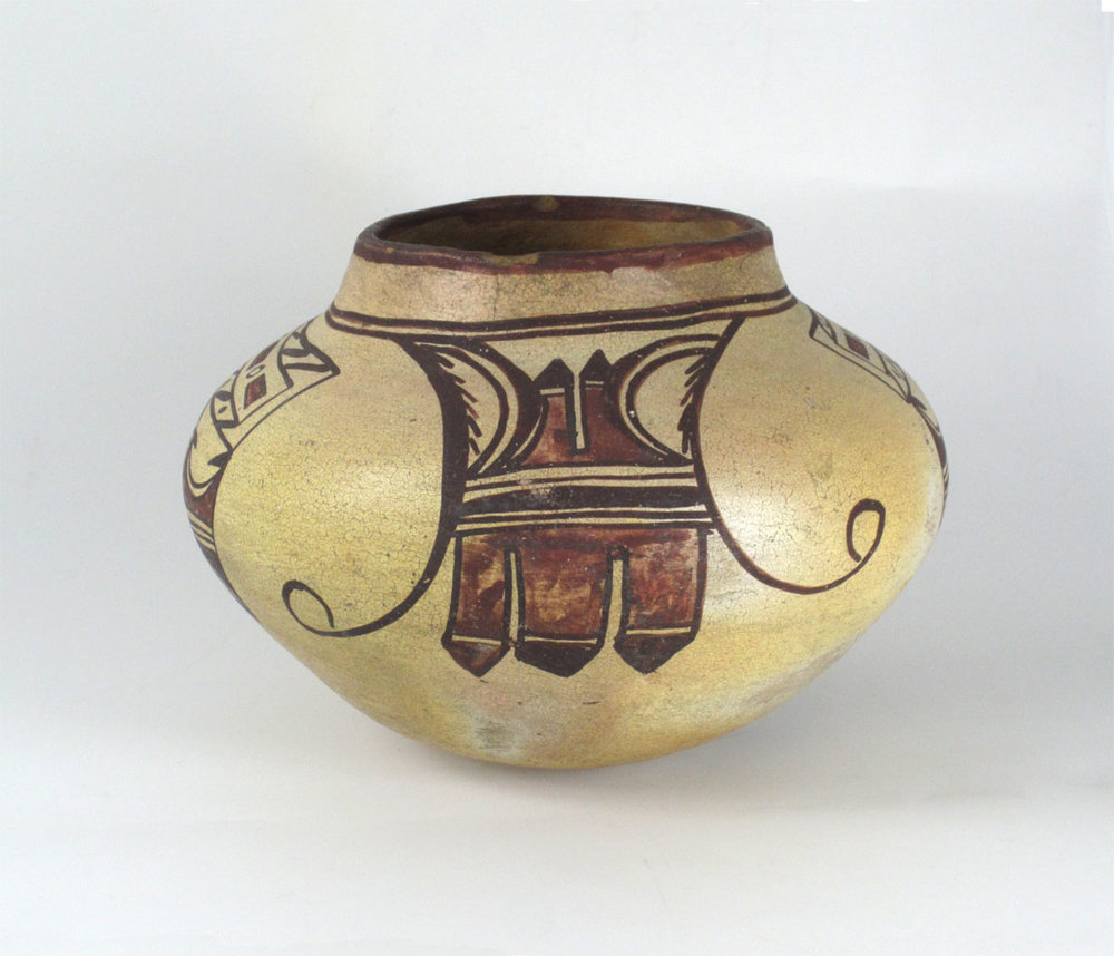 Hopi Polacca jar   http://www.marcyburns.com/pottery-collection/hopi-polacca-polychrome-jar-1
