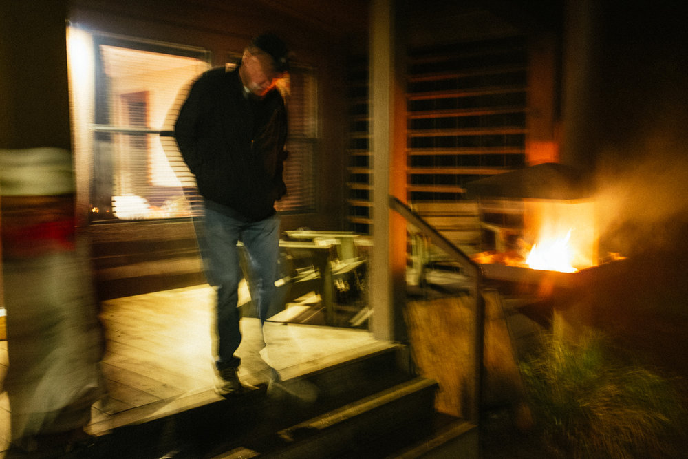 Leland leaving the cabin.