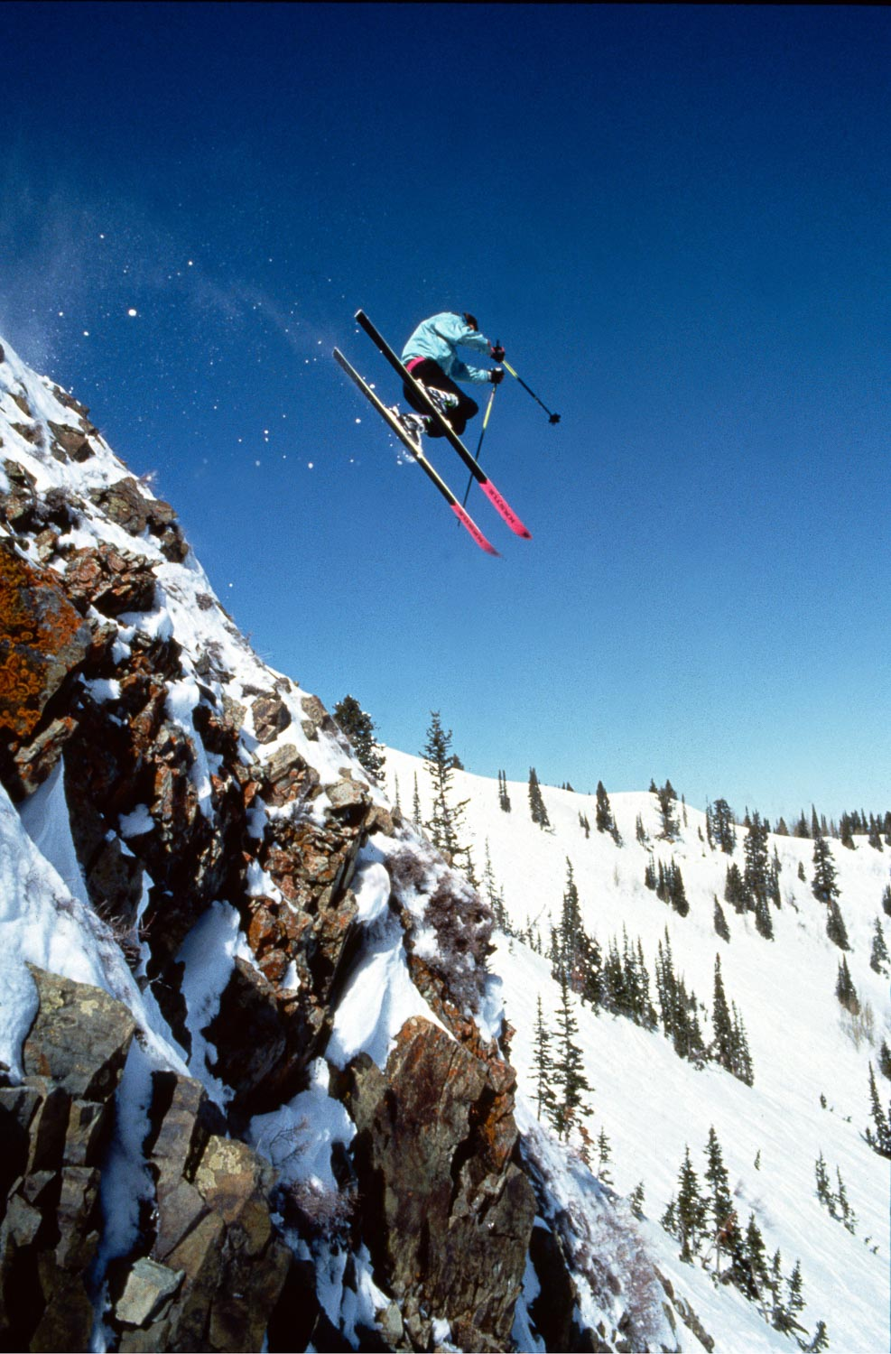 Tom McDonald flies off a cliff band below Jupiter Peak, Park City Mountain. 1990. Photo © Mark Maziarz