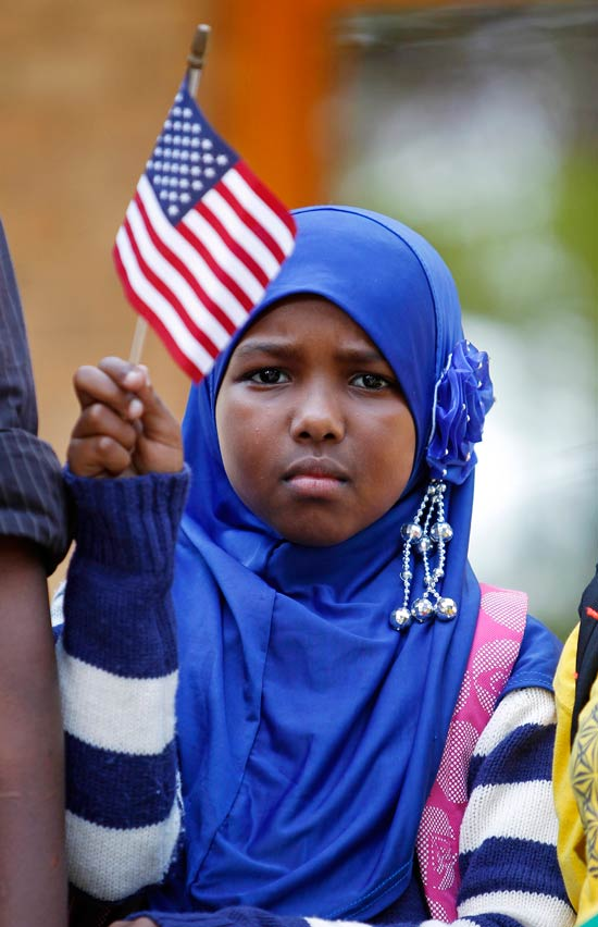 On September 27, 2013, hundreds, including Ilhan Issa, gathered at a solidarity rally in Minneapolis to protest terrorist attacks by Al-Shabab. (AP)