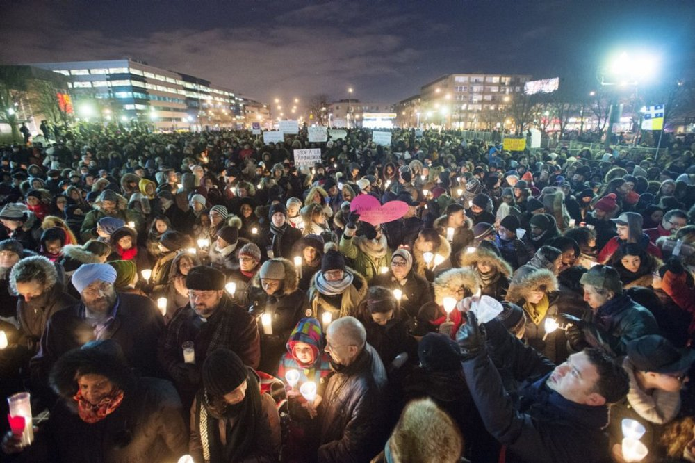 People attend a vigil for victims of the Quebec City mosque shooting in Montreal (RYAN REMIORZ / THE CANADIAN PRESS)