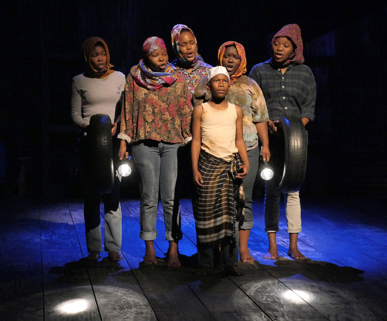 """Cast members in a scene from """"A Man of Good Hope,"""" in London's Young Vic production (Keith Pattison"""