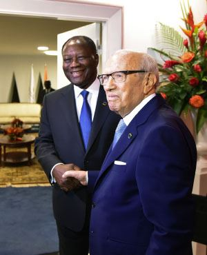 Ivory Coast President Alassane Ouattara (L) with Tunisian President Beji Caid el Sebsi prior to opening of the EU-AU summit, Abidjan, Ivory Coast (Sia Kambou, AFP)