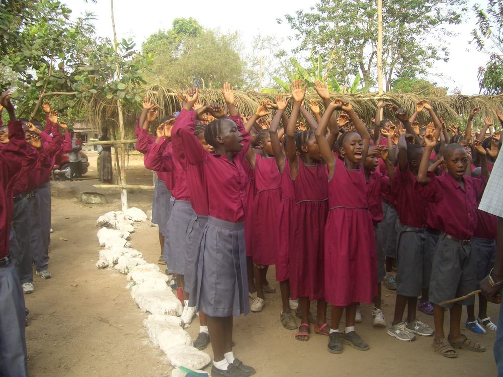 Children meet out front at the beginning of school to sing songs to Jesus.