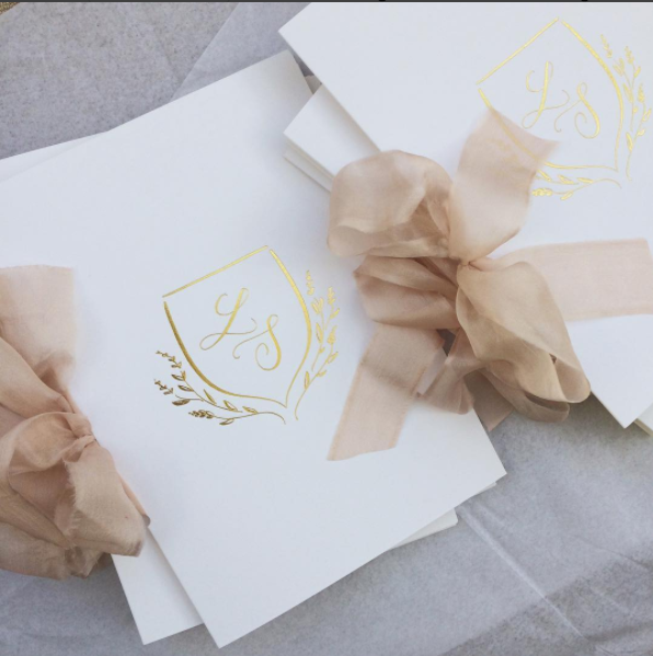 Gold foil and silk ribbon invitations for an Aynhoe Park wedding