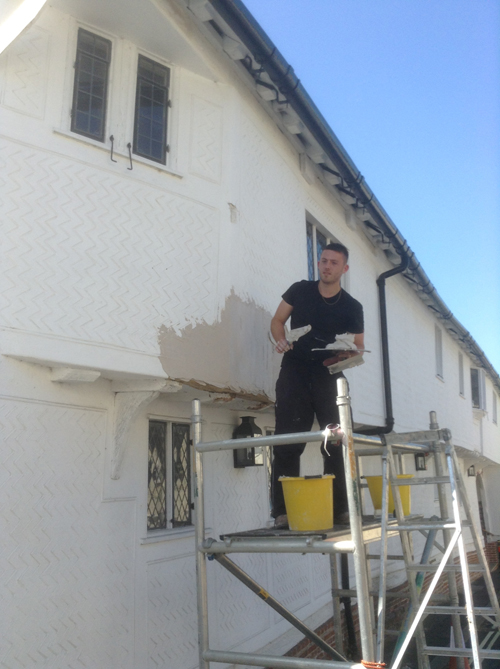 Jamie earlier this year repairing the Guildhall Church hill facade