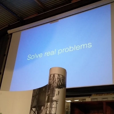 """Slide in einem Talk: """"Solve real problems"""""""