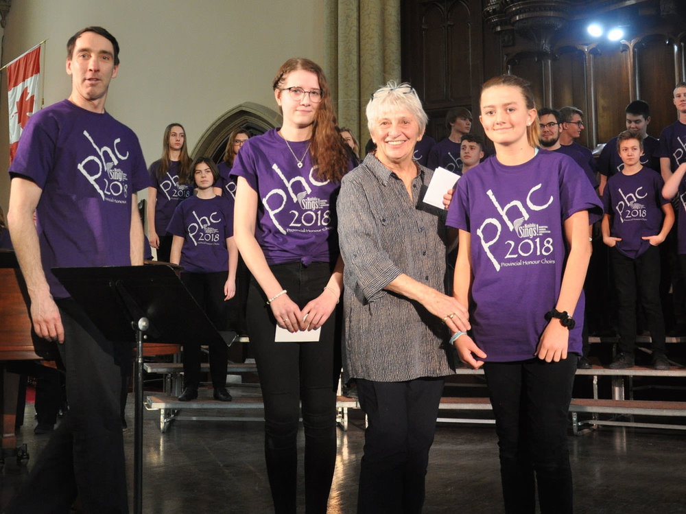 PHC Scholarships - PHC Chair, Marilyn Redekop, presents scholarships for 2019 to:Jonathan Britton, Adult ChoirEmily Wiebe, Senior ChoirEmilyn Nestibo, Junior Choir