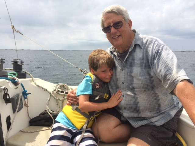 multigenerational vacation grandfather grandson boat