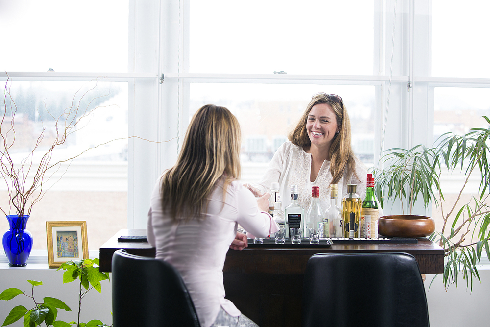 Marketing image showing two woman enjoying a drink in a downtown condo.