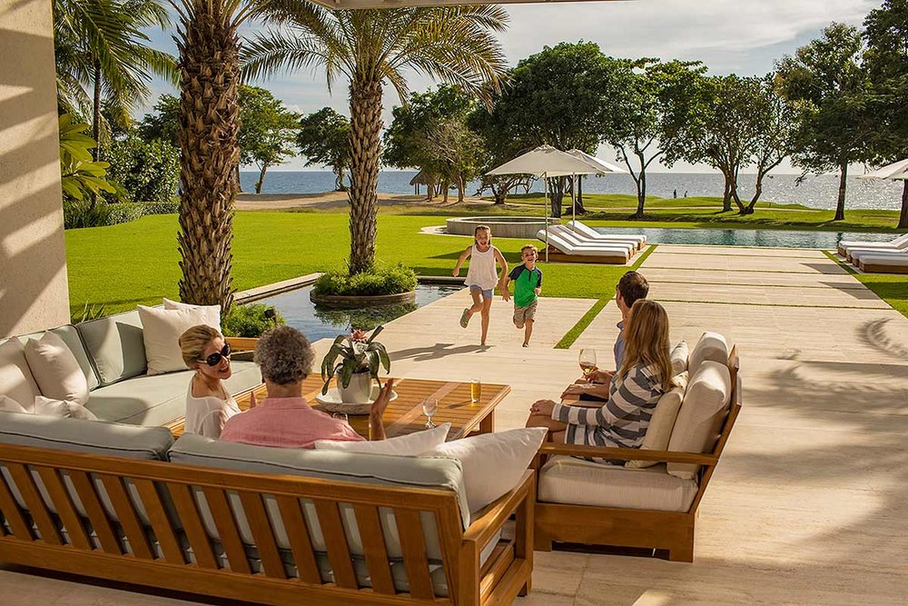 Family enjoys the afternoon at a Villa in Casa de Campo in the Dominican Republic.
