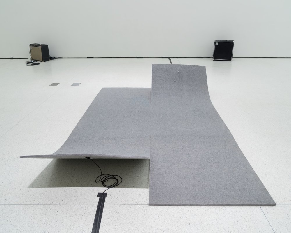 Work On Felt (Variation 3), 2014, felt, carbon fiber, epoxy, wood, guitar tuning peg, piano string, piezo, amplifier,  71 x 114 in. Photo: Kristopher McKay, © Solomon R. Guggenheim Foundation, New York.