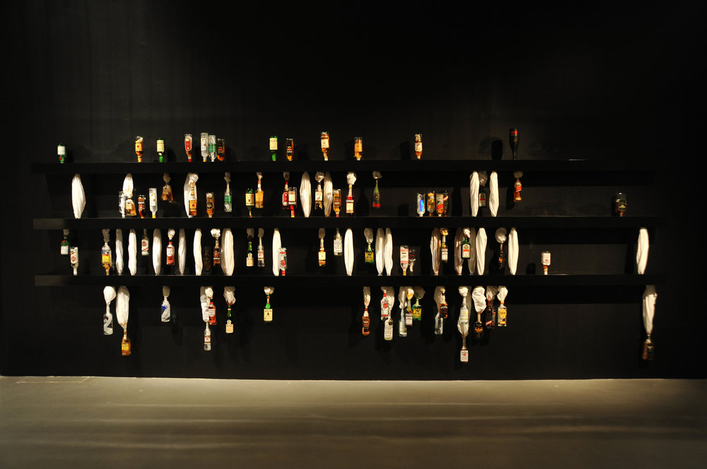 SWEAT, 2010, Full liquor bottles, bed sheets and shelves, Dimensions variable