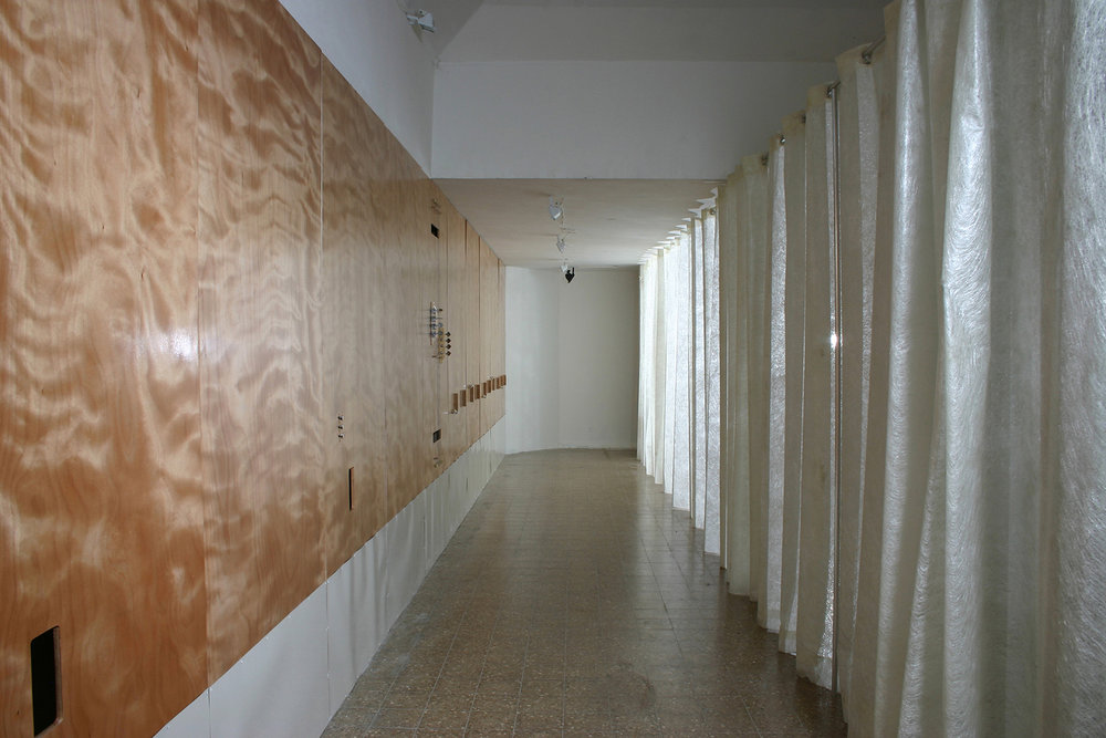 Untitled (String Wall), 2004, Site-specific installation, Wood, strings, guitar tuners, brass, fiber glass mesh, Dimensions variable