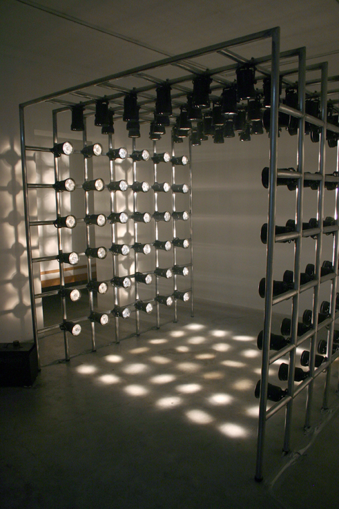 Untitled (Light Cube), 2004, Aluminum poles, pin spot lights, fog machine, 6.8' x 6.8' x 6.8'. *Image from Sommer Gallery