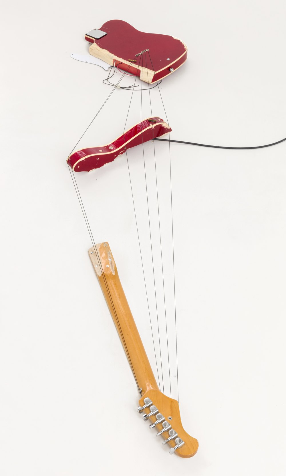 """Melody of Certain Damage #1, 2018, broken electric guitar, strings, microphone, screws and amplifier, 73""""x17""""x4"""". Image by Chris Stach"""