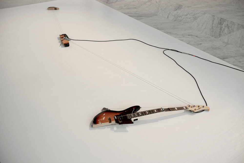Melody of Certain Damage #7, 2018, broken electric guitar, strings, microphone, screws and amplifier. Image by Jorge Miño