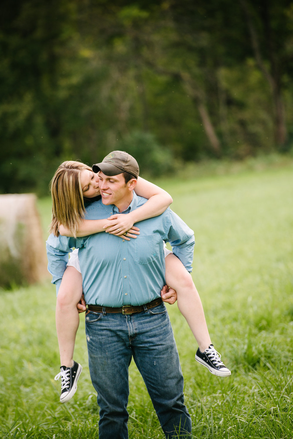 Piggy back rides from fiance during engagement photos.