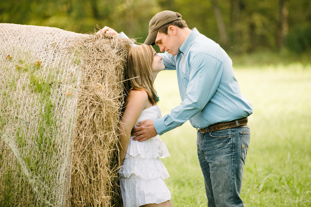 Pinned between a cute guy and a hay bale.