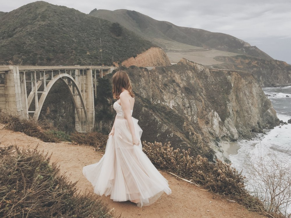 Sarah Rotrock of The Rucksack Refinery on Bixby Creek Bridge in Big Sur California