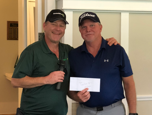 Chase Eads. Longest Drive on hole #9 winner, with Brad Martin.