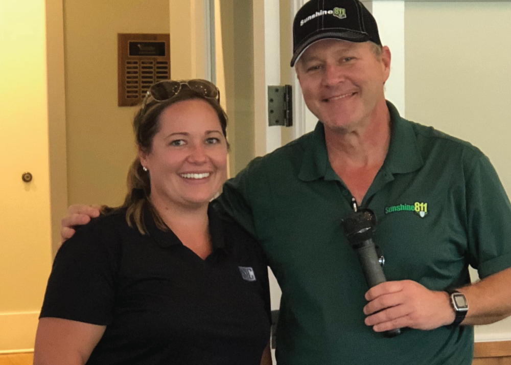 Lauren Griffen, winner of the Women's Longest Drive, pictured with Brad Martin, Sunshine 811 liaison.