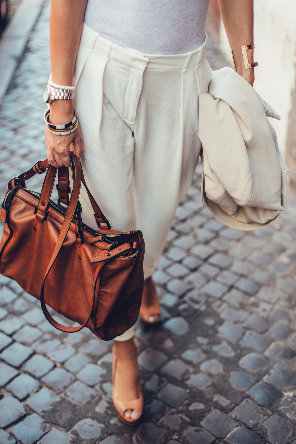 Woman Carrying a Brown Leather Handbag