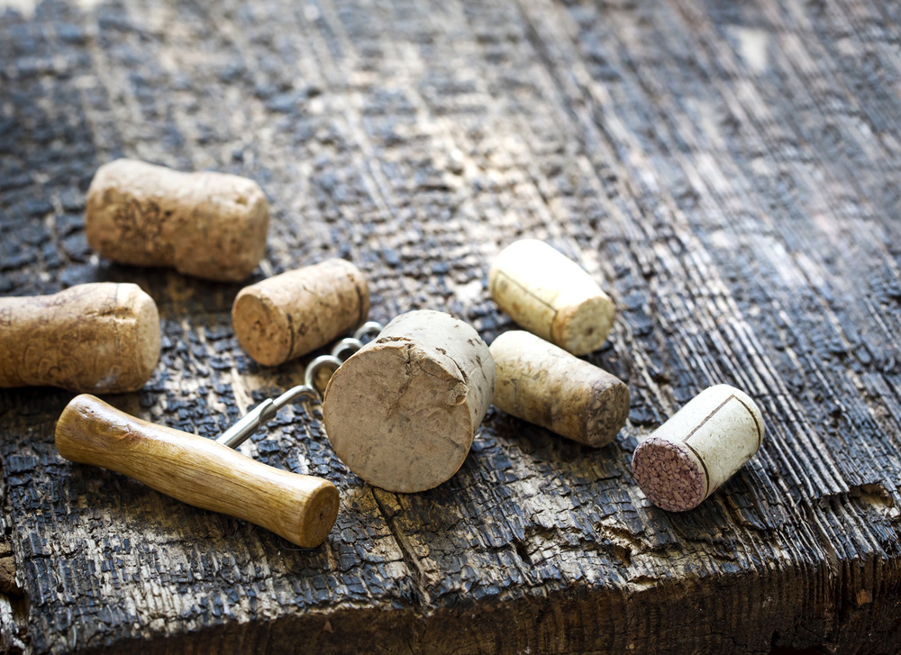 Wine-Corks-on-Wooden-Table.jpg