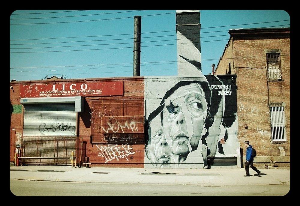 Craig Shepard walks past a mural during 2012s ON FOOT: BROOKLYN. Photo by Beth O'Brien.