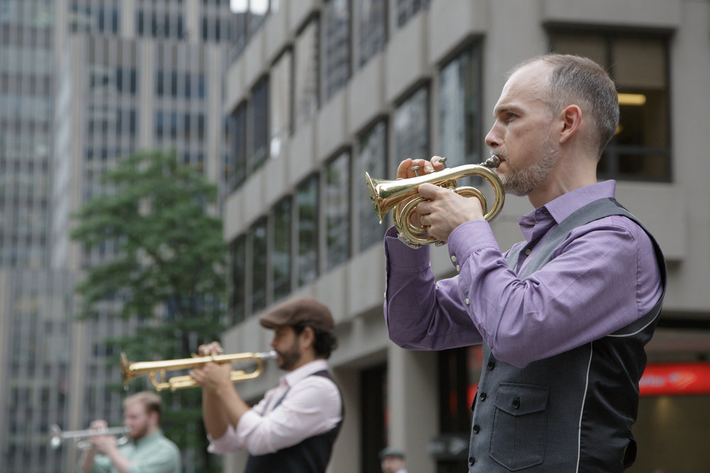 From R: Craig Shepard, Phil Rodriguez, Cyril Bodnar perform on Park Avenue in New York. Photo by Beth O'Brien