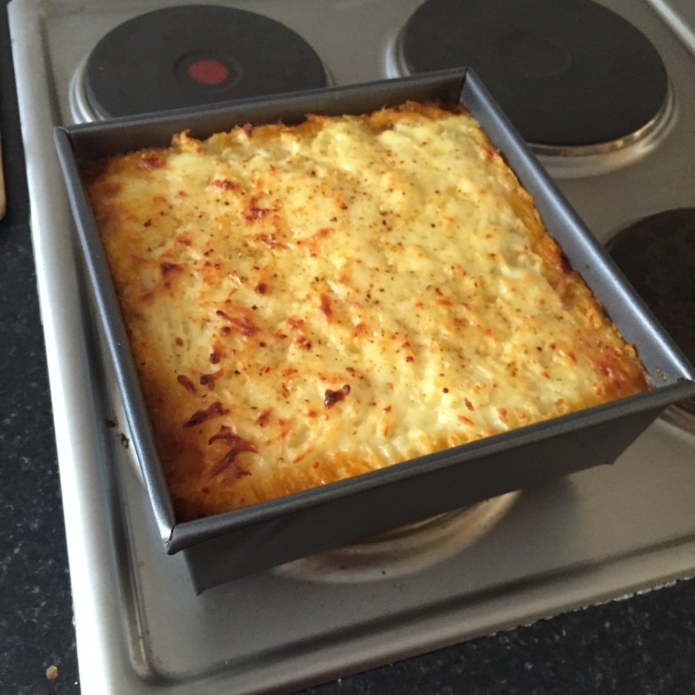 A hearty homemade cottage pie with a lovely cheddar/mozarella cheese baked crust on top.