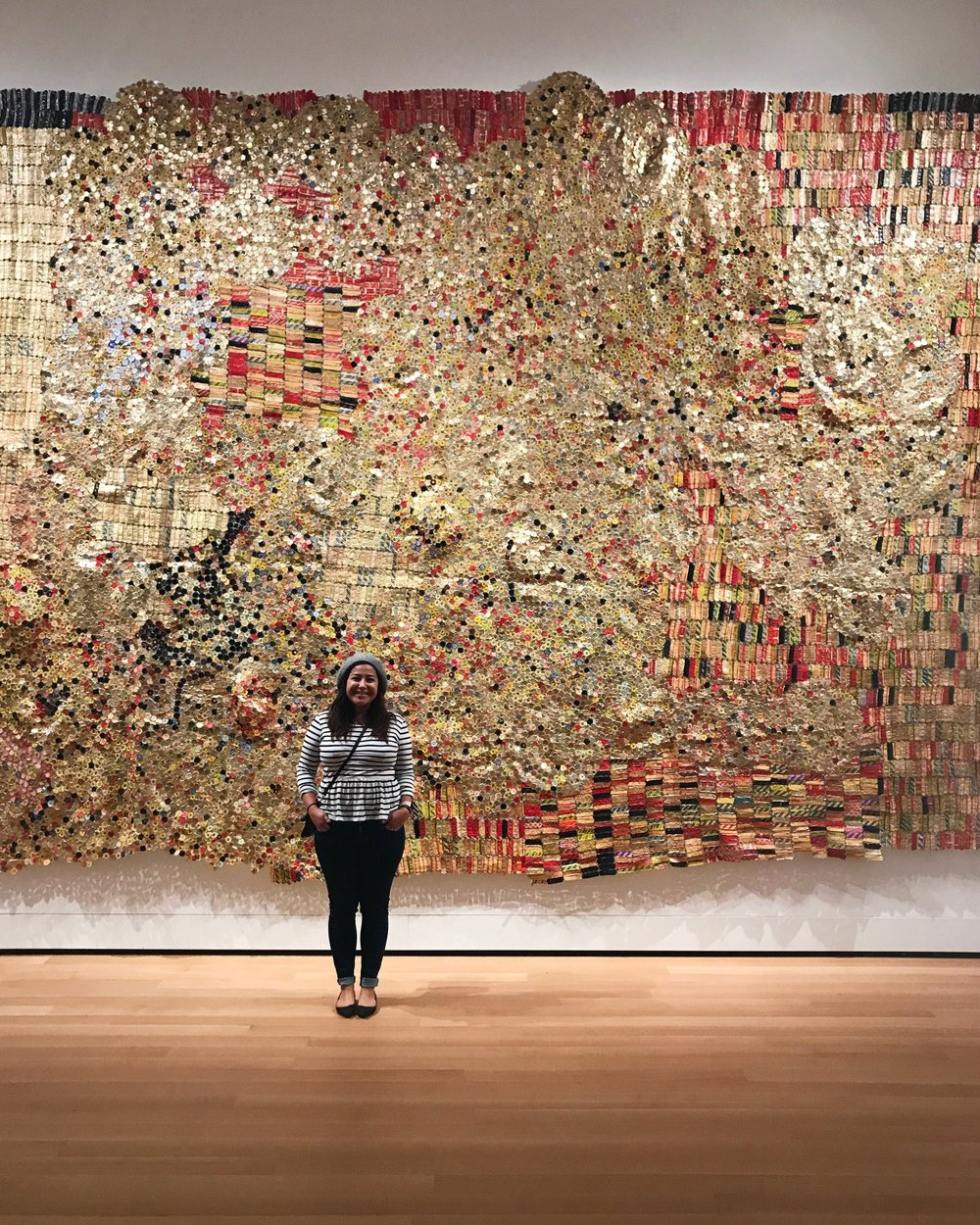 El Anatsui!! Think I can make one of these from La Croix cans?