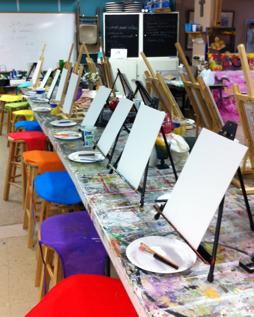 rows-of-easles-set-up-with-colorful-smocks-before-tracey-marshall-art-class-for-childre-2n.jpg