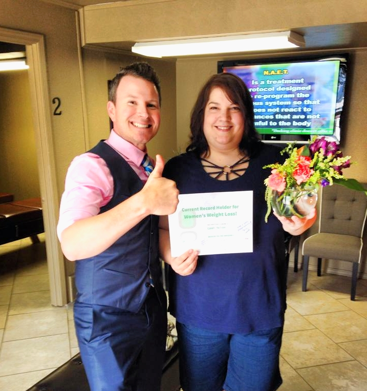 Dr. Becking and Candi Nelson strick a pose as we celebrate her setting the new female weight loss record for our clinic.