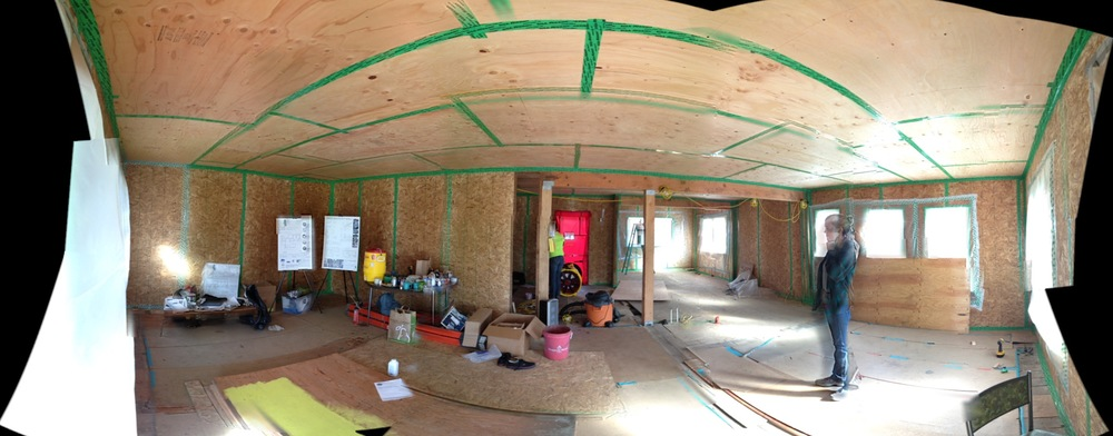Our first blower door test after the walls were closed in and seams taped, measuring less than 1 air change per hour (< 1 ACH)