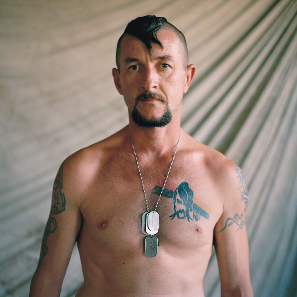 Soldier, Artillery battalion of the Ukrainian Ground Forces bearing a cossack tattoo and hairstyle in Novooleksandrivka, Ukraine.