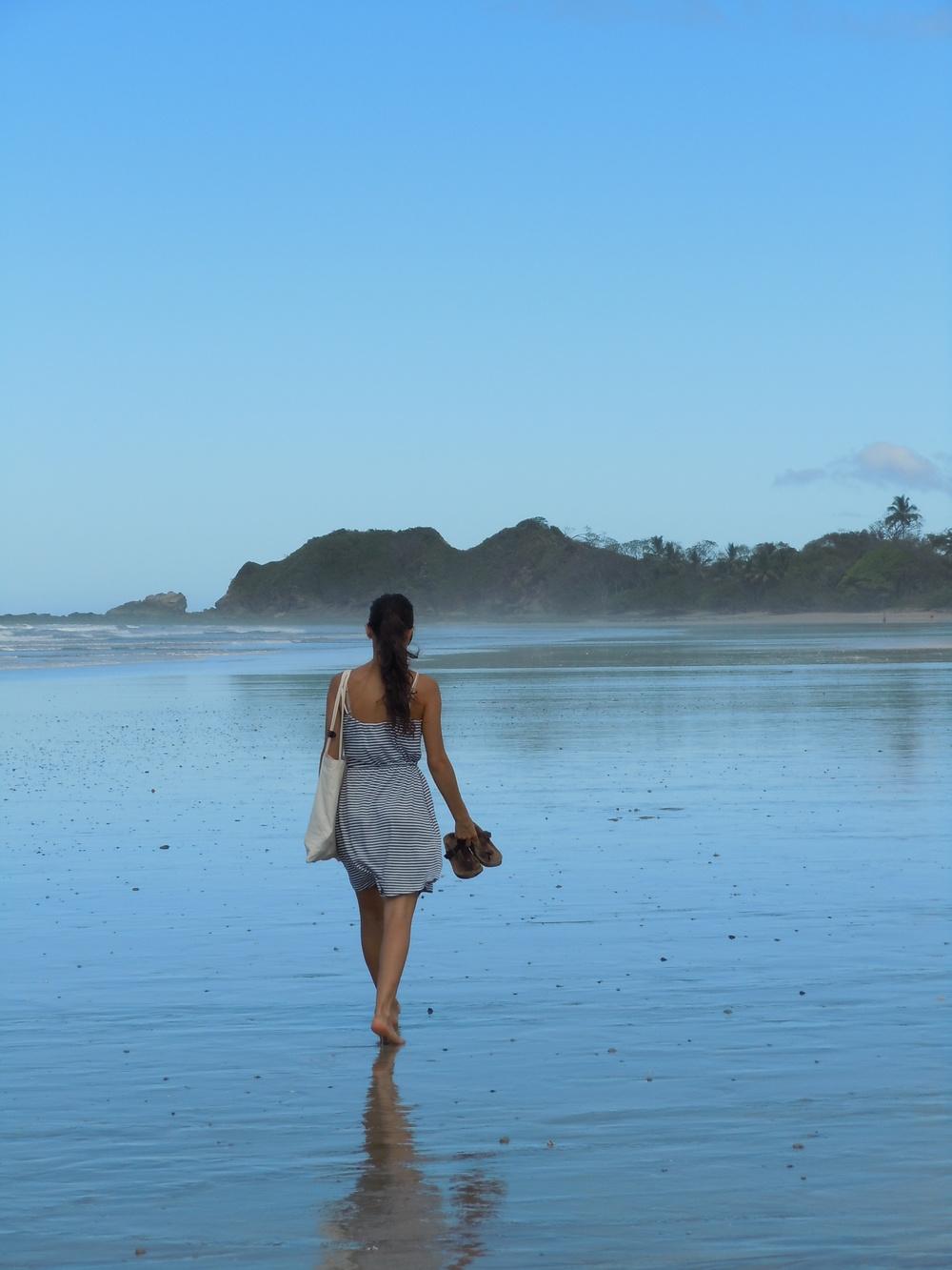 Walking along Playa Guiones.